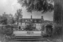 A monochrome photograph of the main house at Great Comp Gardens, near Sevenoaks in Kent.