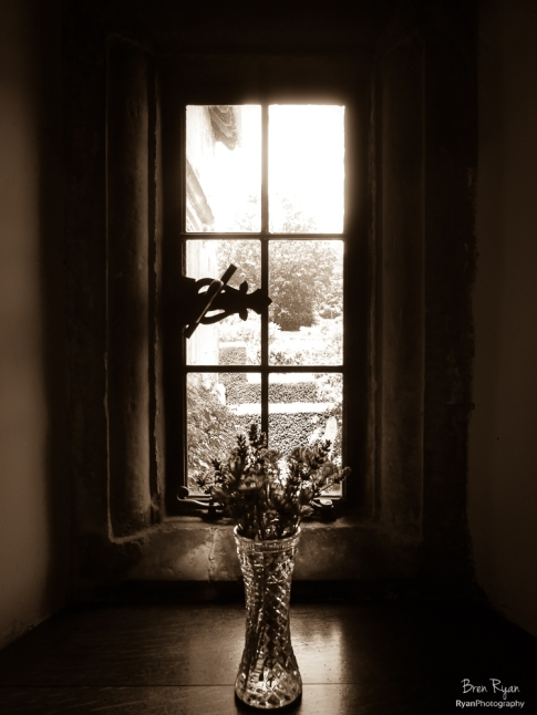 A sepia toned photograph of a window taken at Bateman's House