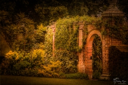 A photograph of one of the brick build arches at Hole Park in Rolvenden in Kent.
