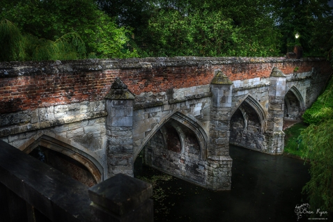 A photograph of the bridge at Eltham Palace Gardens that spans the moat.