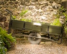 Wheelbarrow within the gardens of Ightham Mote