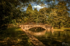 A photograph of the bridge going over the lake at Kearsney Abbey Gardens, near Dover in Kent.