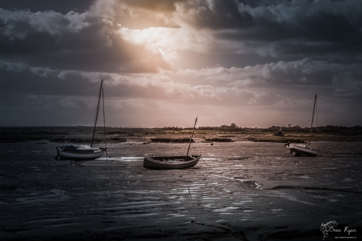 Boats on the mud flats of Leigh on Sea in Essex.