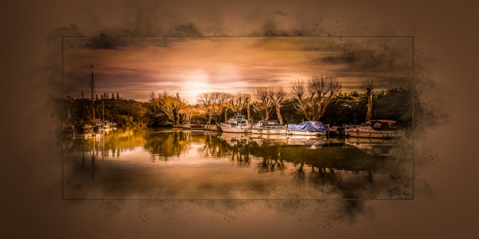 A photograph of the boats and barges moored at Allington Locks near Maidstone in Kent.