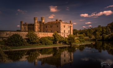 A photograph of Leeds Castle and the moat.