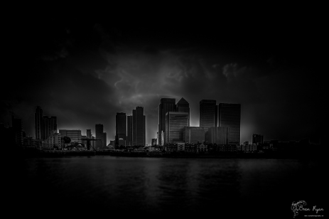 A monochrome photograph of Canary Wharf taken from North Greenwich London