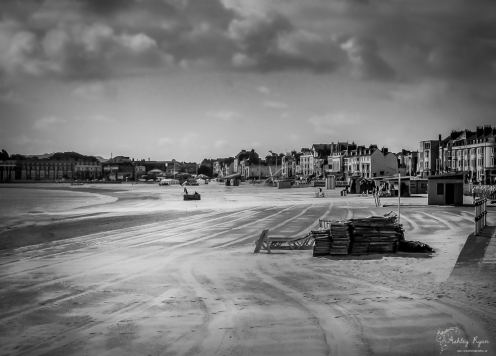 A monochrome photograph of the beach at Weymouth.