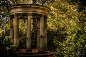 A photograph of the concrete gazebo at Pashley Manor Gardens which is situated by the Anne Boleyn statue.