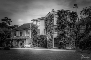 A monochrome photograph of the rear of Down House in Kent