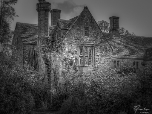 A monochrome photograph of the main house at Nymans in West Sussex.