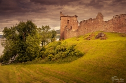 A photograph of Urquhart Castle overlooking Loch Ness in Scotland.
