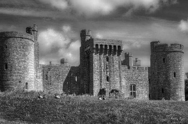 A monochrome photograph of Bodiam Castle
