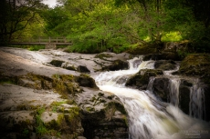 A photograph of cascading water at Aria Force in Cumbria.