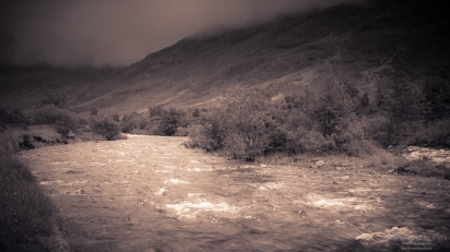 A photograph of the RIver Coe just as the rain clouds appeared over the mountains.