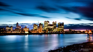 A monochome photograph of Canary Wharf at night.