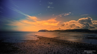 A photograph of a sunset at Llundudno Beach in Wales.
