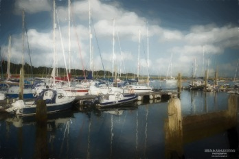 A photograph of boats moored at Riverside Marina in Lymington, Hampshire given a paint effect in Topaz Impression.