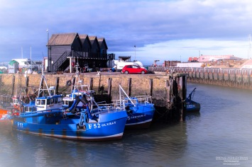 A photograph of boats moored at Whitstable Harbour in Kent.