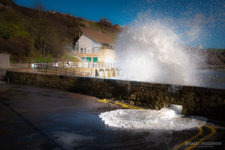 A photograph of waves crashing over the sea wal at Folkestone in Kent.