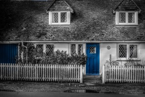 A photograph of a blue door on a cottage at Rye Harbour in East Sussex.