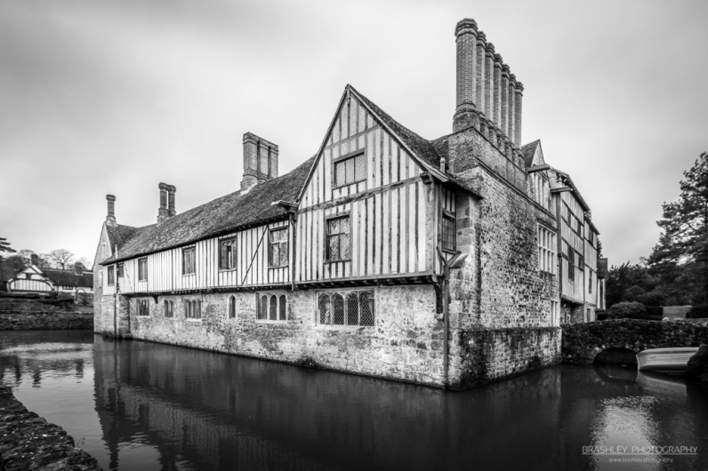 A photograph of Ightham Mote house and its moat.