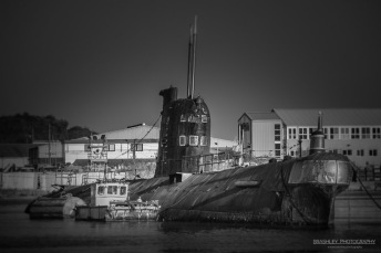 A photograph of a nuclear submarine moored on the River Medway at Rochester Kent.